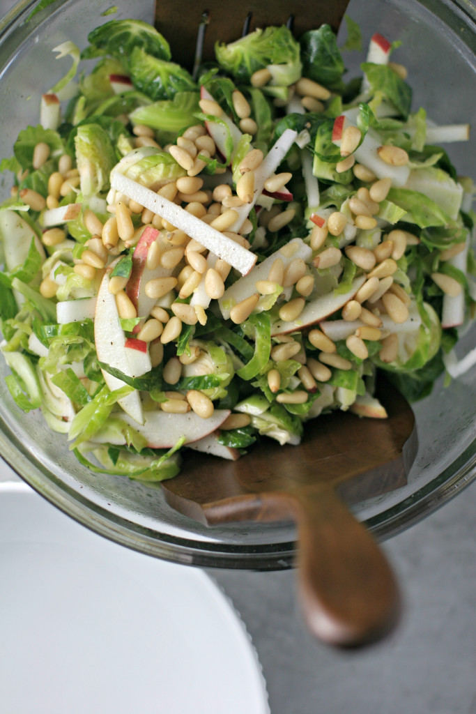 So long summer salads, hello fall veggies! Serve this SHREDDED BRUSSELS SPROUT AND APPLE SALAD at any of your fall feasts for a healthy swap!