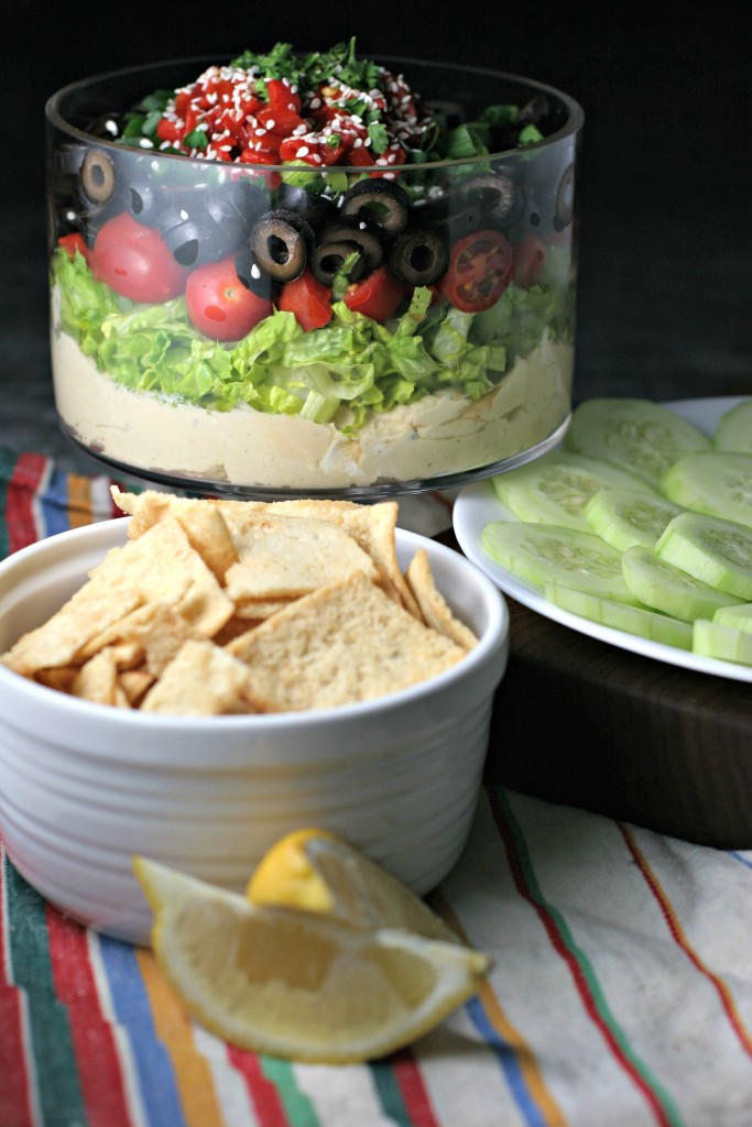 Hummus Layer Dip, lemon scented hummus loaded with fresh veggies, a healthy addition to any Super Bowl party!