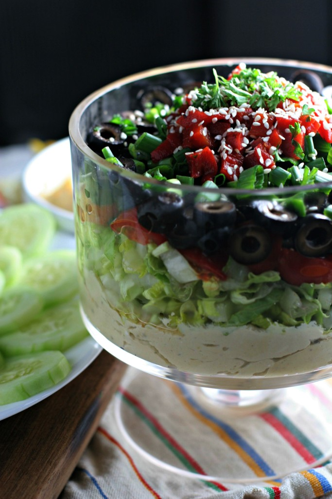 Hummus Layer Dip, lemon scented hummus loaded with fresh veggies. A healthy addition to any Super Bowl party!